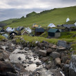 Stock Photo: Houses and stream in village of Island Mykines, Faroe Islands
