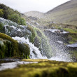 Splashing water of waterfall on Faroe Islands - Lizenzfreies Foto