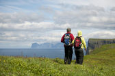 Couple hiking on Mykines, Faroe Islands — Stock Photo