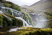Splashing water of waterfall on Faroe Islands — Stock Photo