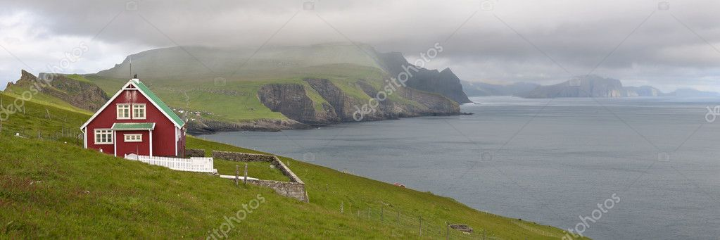Red farmhouse on coast of Mykines, Faroe Islands — Stock Photo #10903822