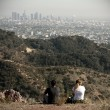 Two persons looking at Los Angeles, California, USA - Stock Photo
