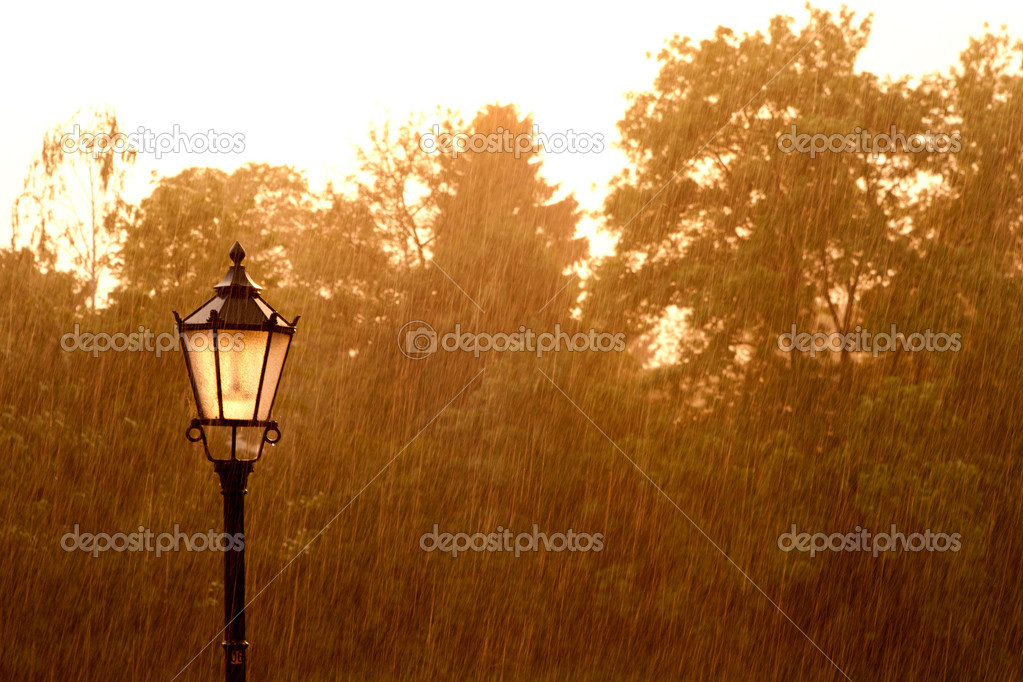Street lamp in the rain during the sunshine  Stock Photo #10894628