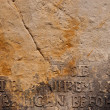 Ancient German Inscription on Broken Stone Wall — Stockfoto