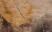 Ancient German Inscription on Broken Stone Wall — Stock Photo