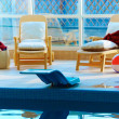 Beach chairs by the indoor pool — Stock Photo