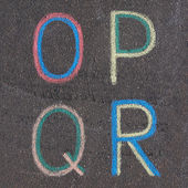 Alphabet letters drawn on asphalt with chalk, o, p, q, r — Stock Photo