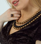 Beautiful woman wearing pearl beads and ring — Stock Photo