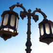 Old street rusty lamp against blue sky — Stock Photo