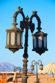 Old rusty street lamps on the beach — Stock Photo