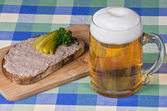 Bread with liverwurst and a glass of beer — Stock Photo