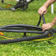 Repairing a flat bicycle tire — Stock fotografie