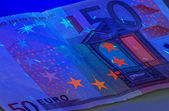 Fifty Euro under ultraviolet light — Stock Photo