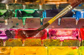 Watercolors with brush — Stock Photo