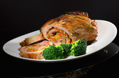 Rolled pork with red pepper and broccoli — Stock Photo