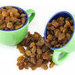 Two coffee cups full of raisins — Stock Photo