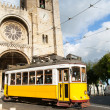 Stock Photo: Characteristic tram tour through streets of Lisbon in Portug