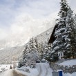 Stock Photo: Snow-covered road in shadow of Dolomites near Cortina