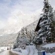 Foto de Stock  : Snow-covered road in shadow of Dolomites near Cortina