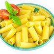 Stock Photo: Bowl full of rigatoni pastwith tomatoes and basil