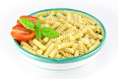 Bowl full of fusilli pasta with tomatoes and basil — Stok fotoğraf