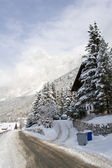 A snow-covered road in the shadow of the Dolomites near Cortina — Stock Photo
