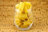 Ditaloni pasta inside transparent glass — Stock Photo