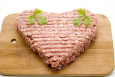 Minced meat in heart form — Stock Photo