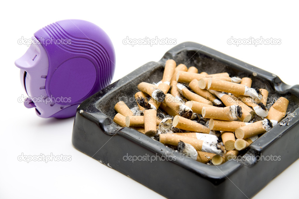 Ashtray with cigarets and Inhaler on white background — Stock Photo #10861628
