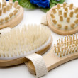 Massage brush with hairbrush — Stock Photo