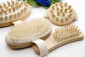 Massage brush with hairbrush — Stock Photo