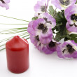 Candle with pansies — Stock Photo