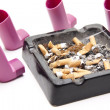 Ashtray with cigarets and Inhaler — Stock Photo