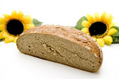 Wheat bread with sunflowers — Stock Photo