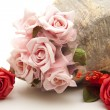 Stock Photo: Roses with stone vase