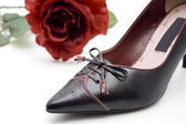 Ladies shoe with rose — Stok fotoğraf