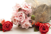 Roses with stone vase — Stock Photo