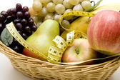 Fruit basket with measuring tape — Stock Photo