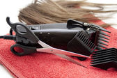 Electric clippers with scissors — Stock Photo