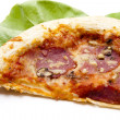 Pizza with salami and salad leaf - Stock Photo