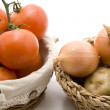Tomatoes and onion in the basket — Stock Photo