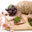 Raw ham with bread - Stock Photo