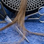 Scissors with hairpiece — Stock Photo