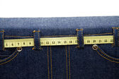Disk briefcase from jeans material with dimension tape — Stock Photo