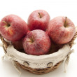 Fresh red apples in basket — Stock Photo