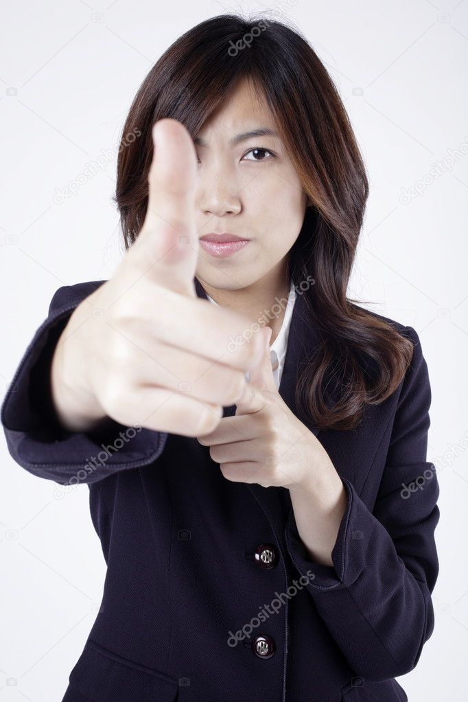 Office lady raises hand to express gun shot.   Stock Photo #11586766