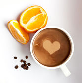 Coffee with a heart symbol, coffee grains and orange — Stock Photo