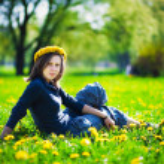 Girl with yellow dandelion's wreath — Stock Photo