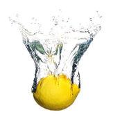 Lemon splashing in water — Stock Photo