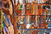 Small bazaar in Cozumel - Mexic with a lot of necklace and bracelet. — Stock Photo